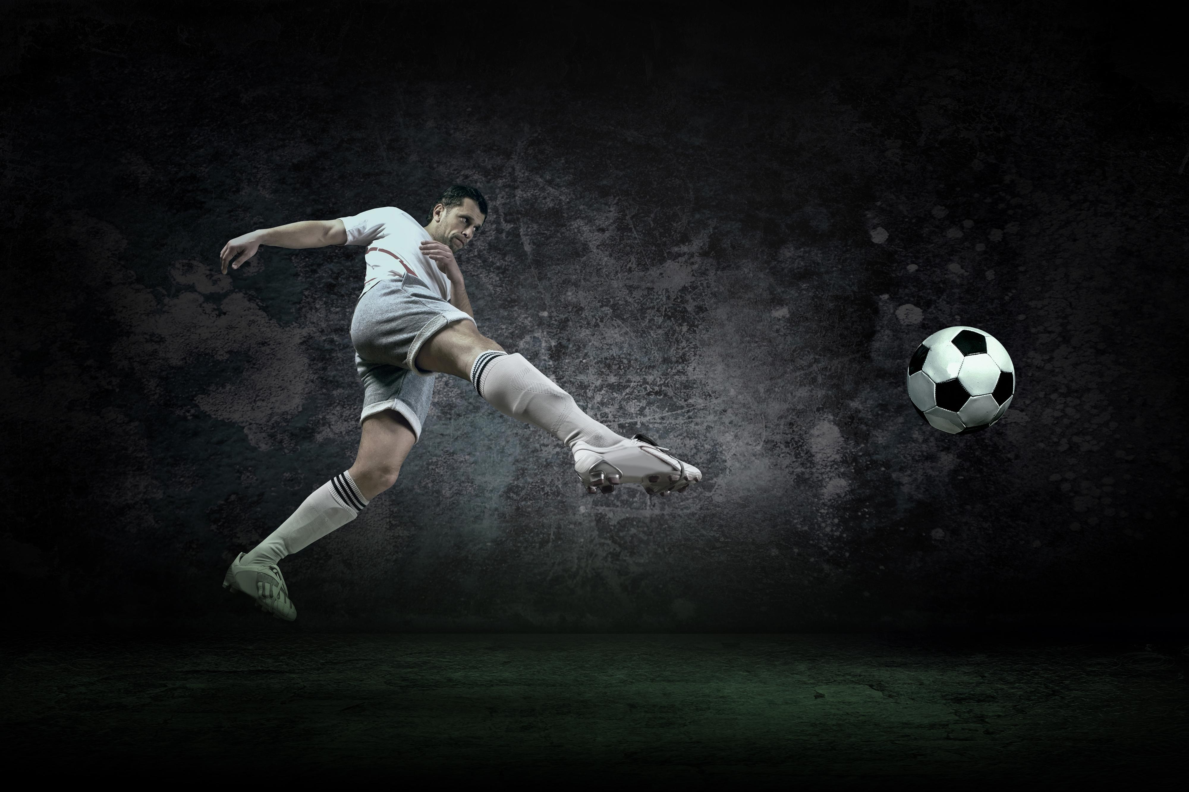 Splash of drops around football player under water